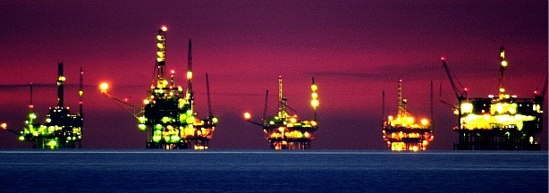 Night comes to oil and gas platforms near the Federal Ecological Reserve in the Santa Barbara Channel.