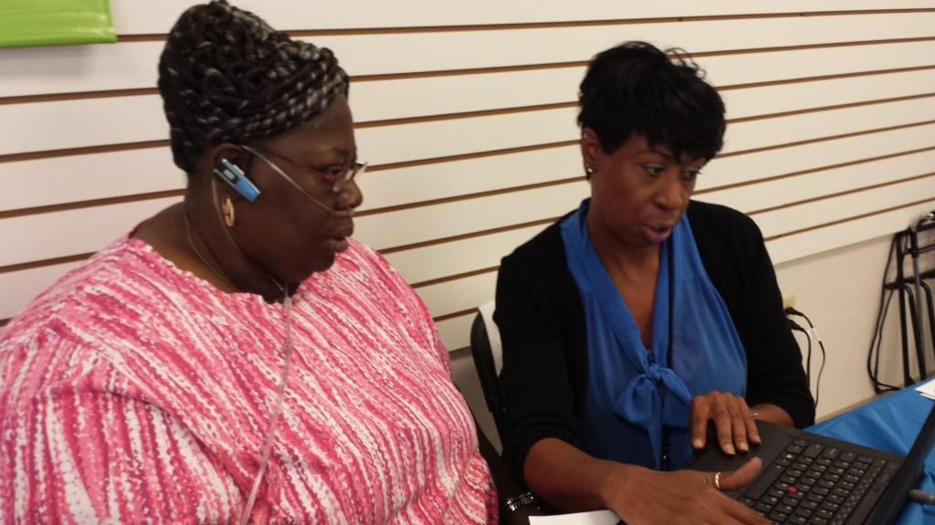 Onita Sanders, right, a certified application counselor at the Southeastern Virginia Health System, helps Virginia resident Brenda Harrell with health coverage options at Enrollfest in Hampton, Va., on Tuesday.