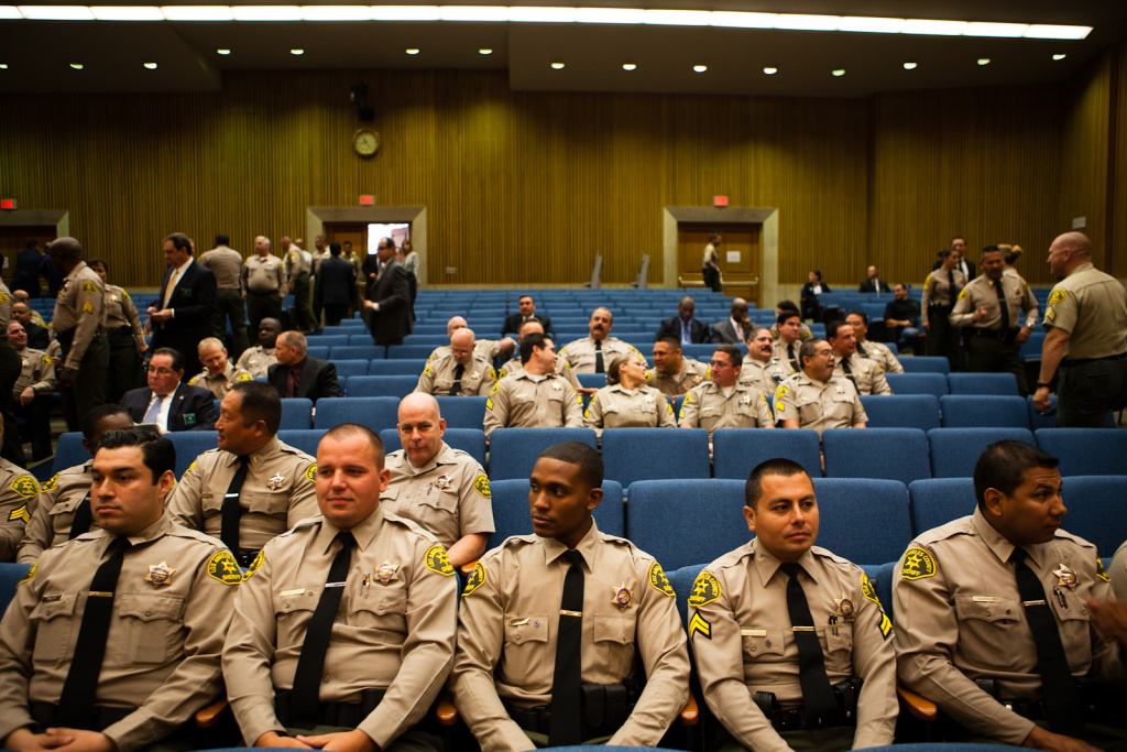 File: Members of the Los Angeles County Sheriff's Department wait for Undersheriff Paul Tanaka's hearing to begin with the County Board of Supervisors on July 27, 2012.