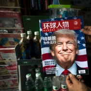 "A copy of the local Chinese magazine Global People with a cover story that translates to ""Why did Trump win"" is seen with a front cover portrait of US president-elect Donald Trump."