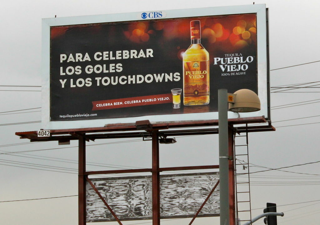 Advertising aimed at bilinguals, like this billboard in Sun Valley, is an increasingly common sight. Nov. 15, 2012.