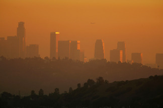 The downtown skyline is enveloped in smog shortly before sunset on in Los Angeles, California. File photo.