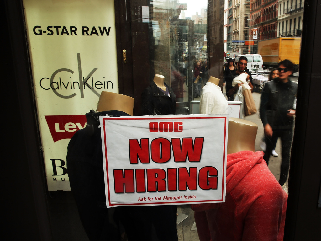A notice in a store window in New York City announces a retail job opening. A survey released Tuesday shows the net share of employers who plan to increase their payrolls in the first quarter of 2015 will be 16 percent in California, right in line with the nationwide hiring outlook.