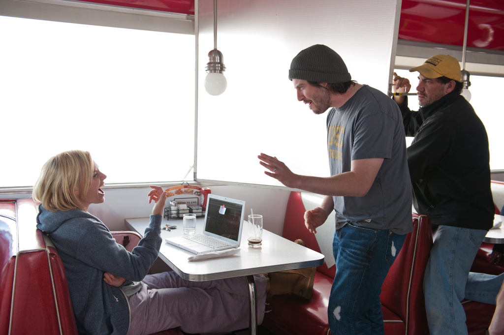 Charlize Theron (as Mavis Gary) discusses a scene with director/producer Jason Reitman on the set of