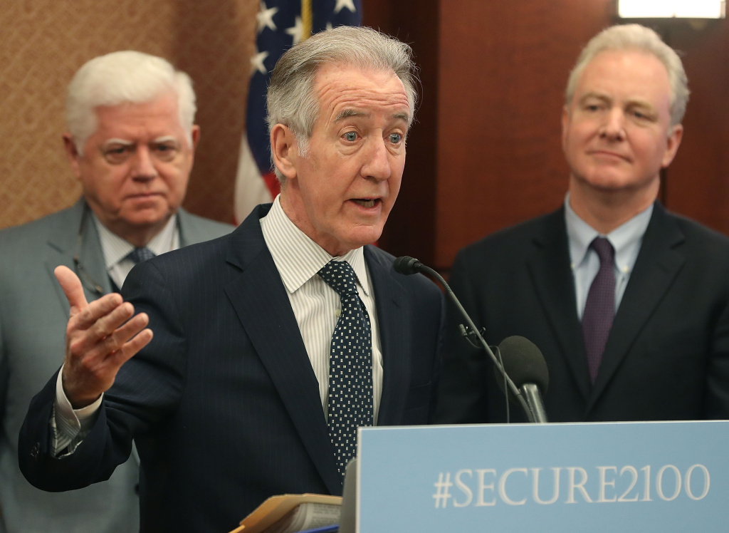 Ways and Means Chairman Richard Neal (D-MA) (C) speaks while flanked by Rep. John Larson (D-CT) (L) and Sen. Chris Van Hollen (D-MD) during an event to introduce legislation called the Social Security 2100 Act.