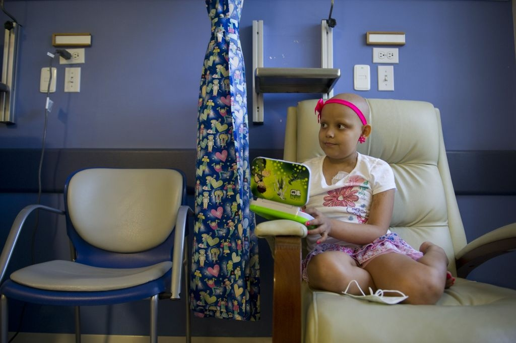 Isabella Osorio, 9, affected by cancer, rests during her chemotherapy session. Recent research suggests existence of cancer stem cells.