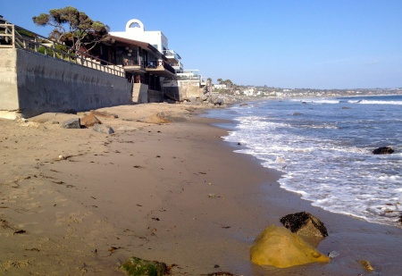 On Broad Beach in Malibu, high tide not only wets sand but also retaining walls and broken down rock revetments. What happens next in homeowners' efforts to get sand trucked in here will go to the State Lands Commission - and the next Controller likely will weigh in on the problem.