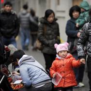 A mother and child walk in Shanghai on F