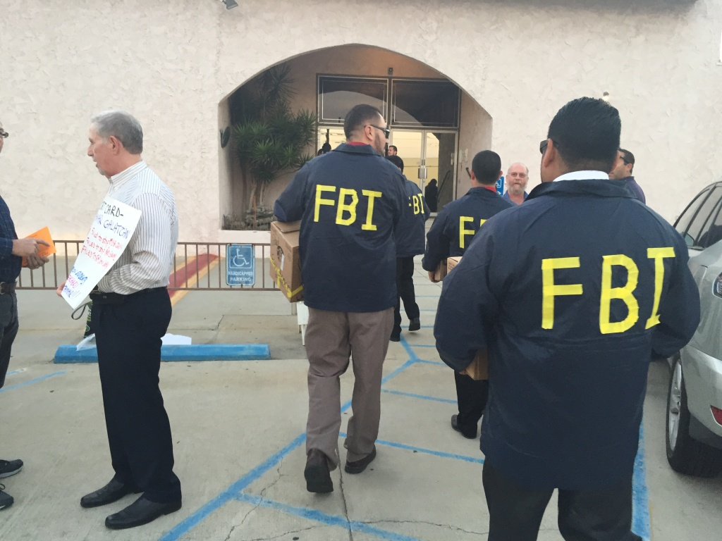 At a recent LAUSD District 3 school board debate, teachers dressed as FBI agents in protest of board member Tamar Galatzan's support of the iPad program.