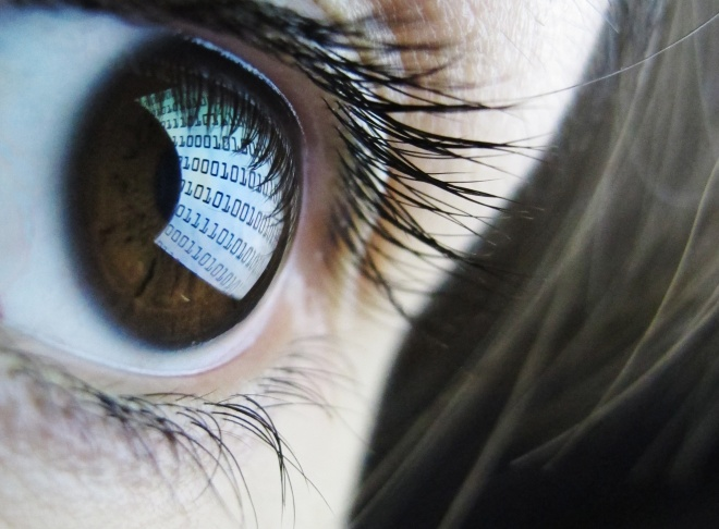 Binary code in woman's eye
