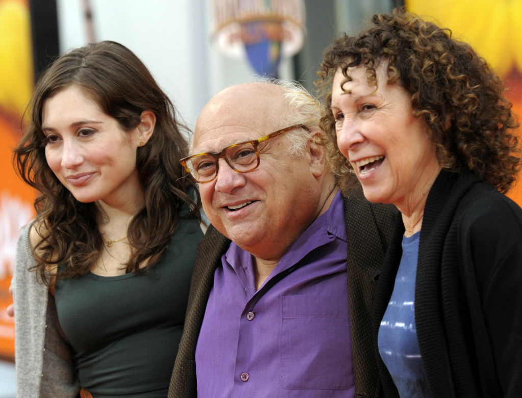 "Actor Danny DeVito, center, his daughter, actress Lucy DeVito, left, and wife, actress Rhea Perlman, arrive at the premiere of the animated feature film ""The Lorax"" in Universal City, Calif. on Sunday, Feb. 19, 2012. (AP Photo/Dan Steinberg)"