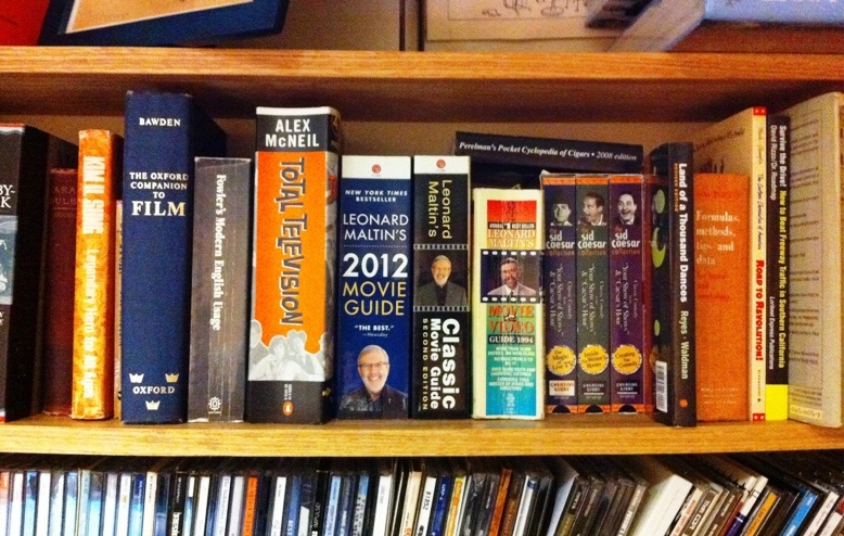 Leonard Maltin takes up valuable inches on John Rabe's reference shelf.