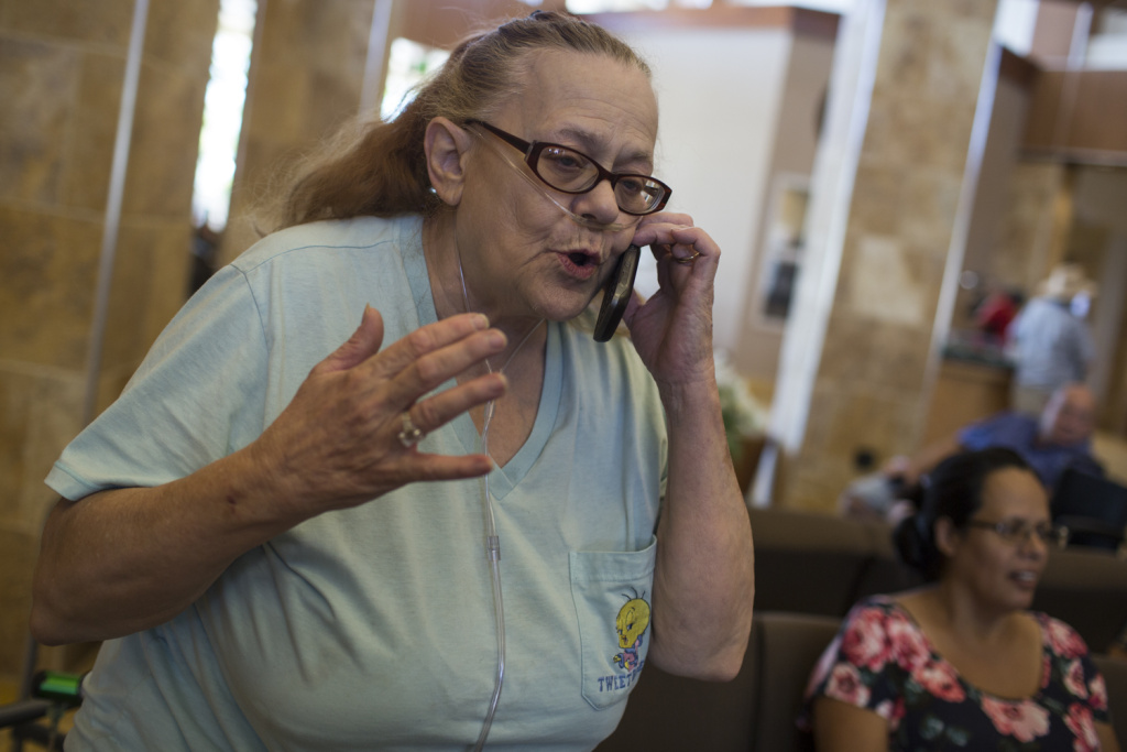 Doris Dodee anxiously awaits to be reunited with her 82-year-old husband, Glen Huffman, at a Red Cross evacuation center at the Jessie Turner Community Center on Wednesday afternoon, Aug. 17, 2016. Her husband flagged down a sheriff to help him get out of the area.