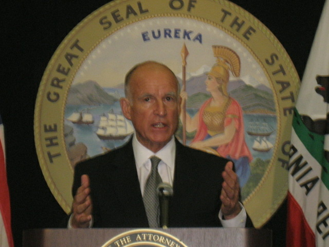 California Attorney Jerry Brown announces he's filing a civil lawsuit against eight current and former city officials in Bell, where big salaries have prompted angry protests.
