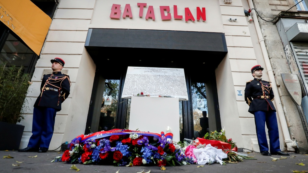 Guards stand in front the Bataclan concert hall in Paris in November 2018, during a ceremony to remember the victims of the attacks in November 2015. On Friday, a man who rented an apartment to two fleeing terrorists received a four-year prison sentence.