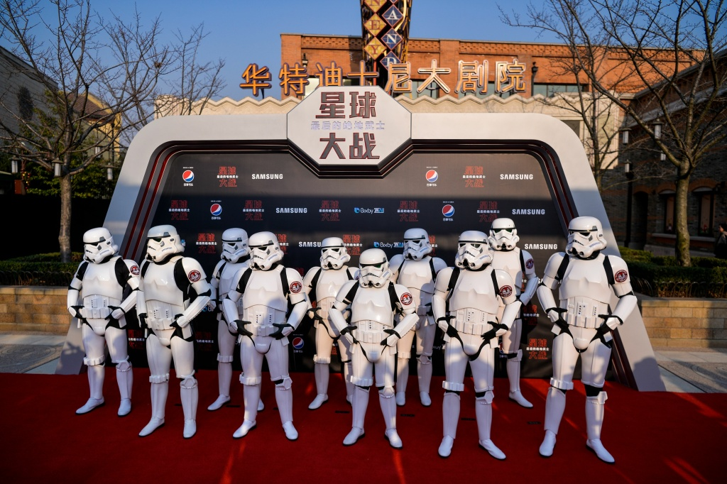 Stormtroopers pose at the red carpet for the Chinese premiere of 'Star Wars: The Last Jedi' at the Shanghai Disney Resort in Shanghai on December 20, 2017.