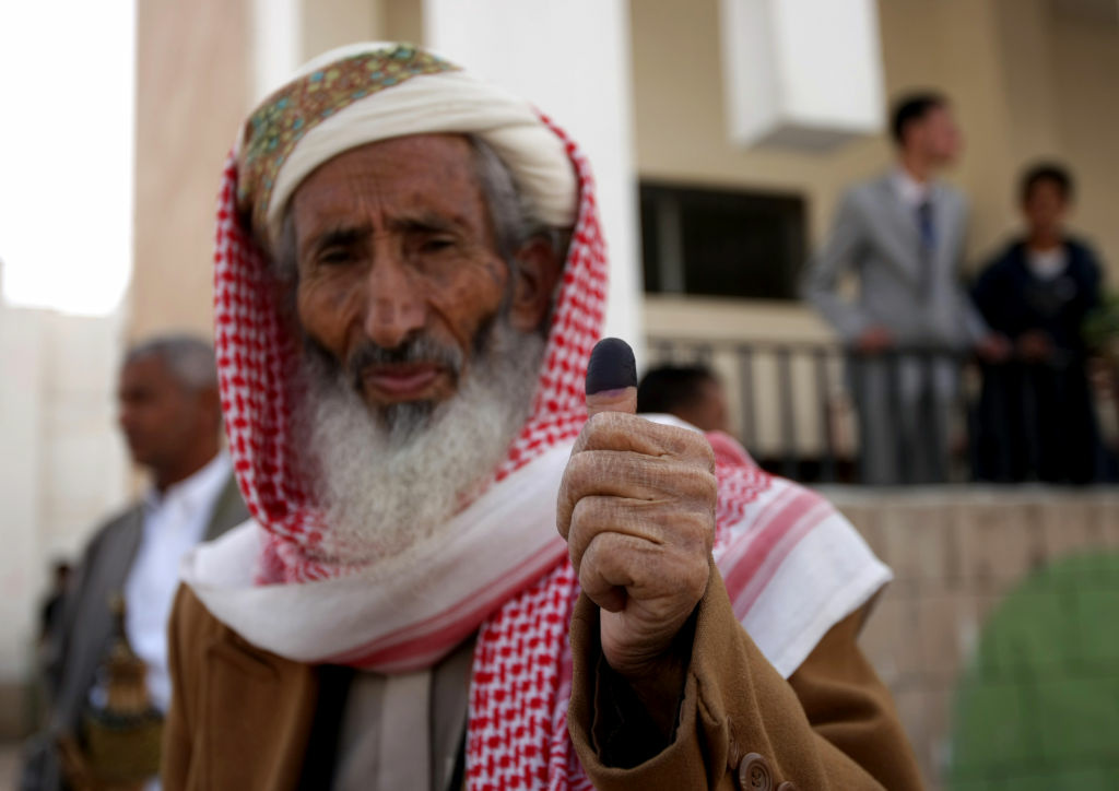 A Yemeni man shows his ink-stained thumb after he voted in Sanaa on February 21, 2012 as the country votes in the presidential election that brings an end to President Ali Abdullah Saleh's 33-year hardline rule in Yemen, the first Arab state where a revolt ended in a negotiated settlement.