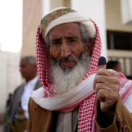 A Yemeni man shows his ink-stained thumb
