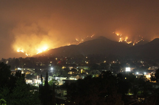 California wildfires light the hillsides of the Tujunga area of Los Angeles on Monday, Aug. 31, 2009.
