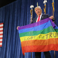 Republican presidential nominee Donald Trump holds a rainbow flag given to him by supporter Max Nowak during a campaign rally at the Bank of Colorado Arena on the campus of University of Northern Colorado October 30, 2016 in Greeley, Colorado.