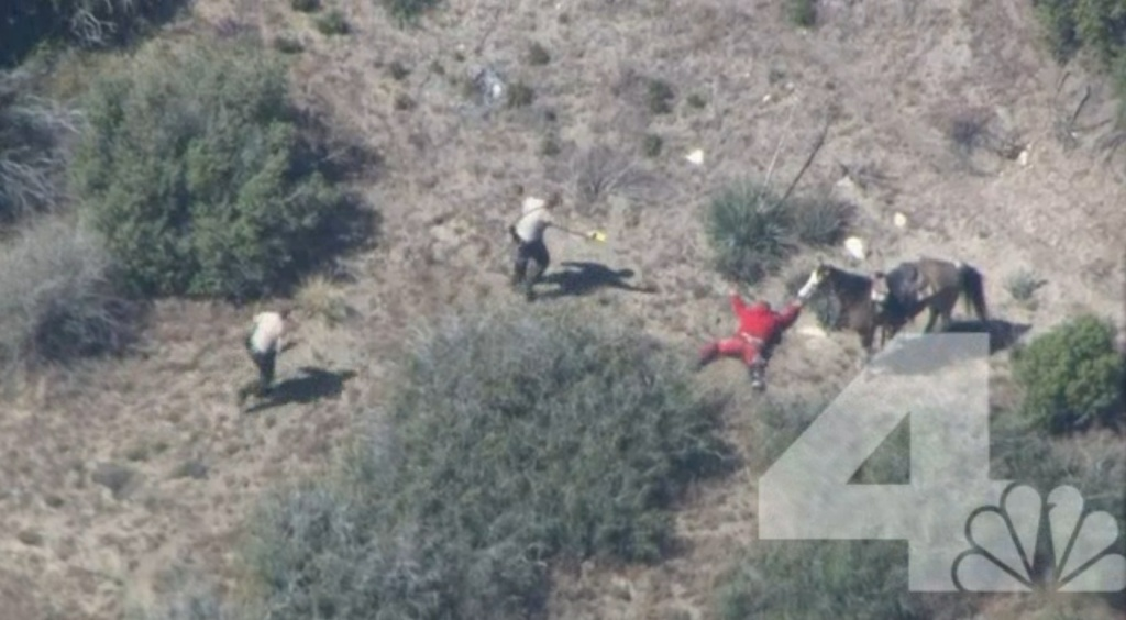 Still image of officers in San Bernardino County apprehending a suspect. The image came from an NBC NewsChopper4 video that shows deputies beating the suspect after leading officers on a wild chase.