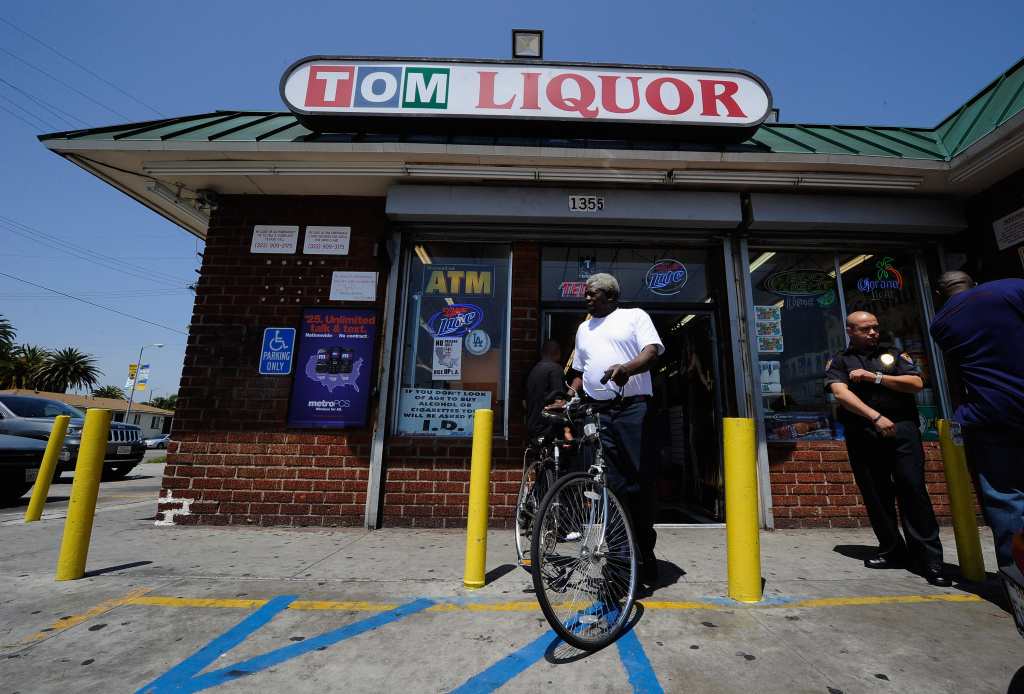A security guard keeps watch outside Tom Liquor store at the intersection of Florence and Normandy Avenues  South Los Angeles on April 27, 2012 in Los Angeles, California.