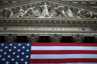 U.S. stocks closed lower on Christmas Eve, as investors worried about the fiscal cliff. Meanwhile, retailers report stronger sales before the holiday, though one tracking group said shoppers were spending less than in 2011.