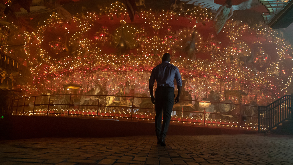 In the <em>American Gods</em> season 2 opener, Shadow (Ricky Whittle) approaches The Carousel, which will ... you know what, it's tough to explain.