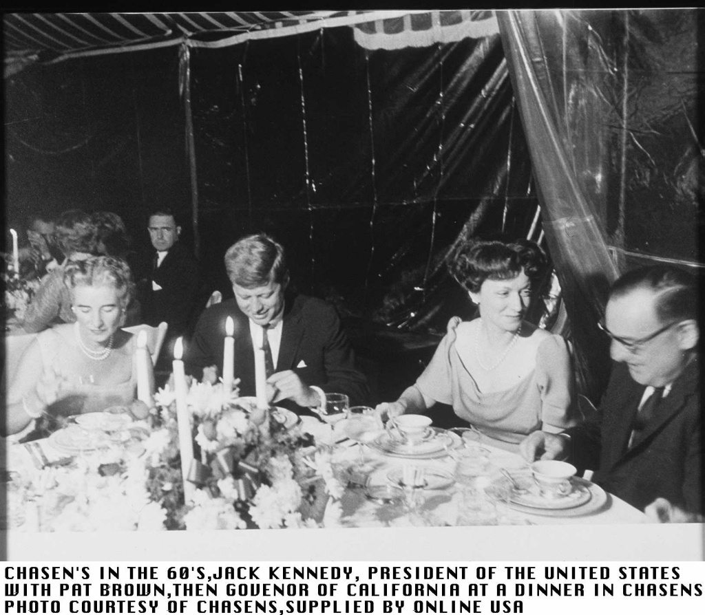 President of the United States Jack Kennedy (L) with then Governor of California Pat Brown (R) at a Chasen's dinner in the 1960s.