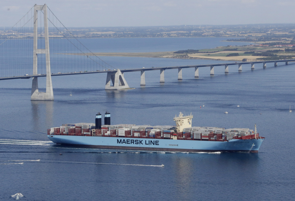 The world's largest container ship, the Maersk Mc-Kinney Moller, which was built in Busan, South Korea, by Danish shipping company Maersk line, and is named after the late ship owner passes the Storebaelts Bridge, Denmark, on the last kilometer of it's maiden voyage, Tuesday Aug. 20, 2013. (AP Photo/Polfoto, Per Rasmussen) DENMARK OUT