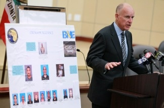 Gov. Jerry Brown, then the California Attorney General, speaks during a news conference on Aug. 31, 2010 in Oakland. Brown announced that law enforcement officers had arrested key members of the Nuestra Familia gang who had orchestrated crimes from inside prison using cell phones. Brown called for a solution to end the use of contraband cellular phones inside prisons.