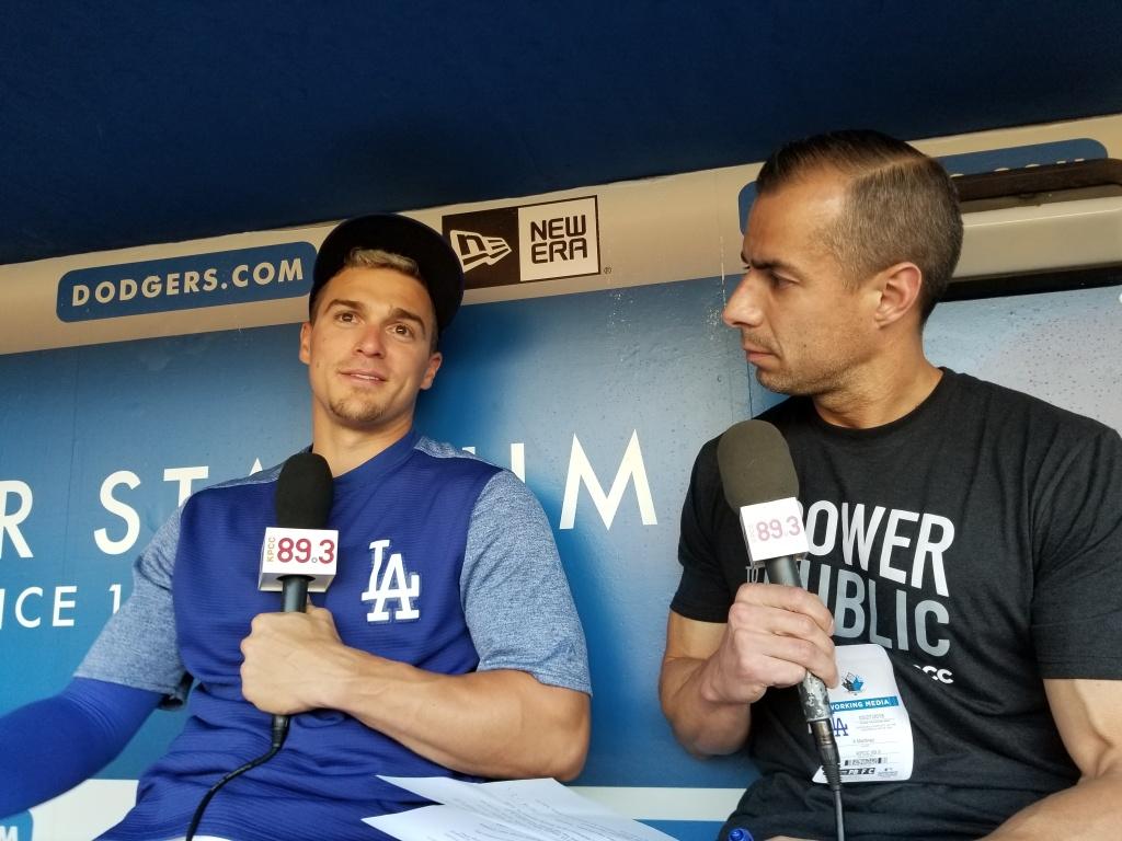 A Martinez talks with Kike Hernandez