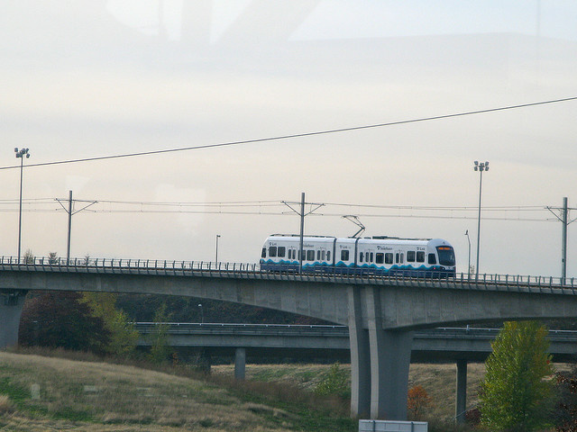 Airport Link testing. A Kinkisharyo-Mitsui LRV is parked on the elevated guideway that leads to SeaTac/Airport station a short distance from Tukwila International Boulevard Station. November, 2009. Kinkisharyo International was just awarded Los Angeles' rail car contract.
