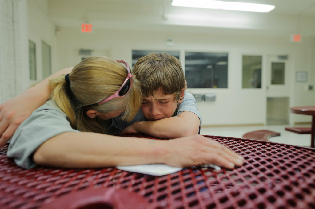 Vinny, at age 13, cries during a visit with his mother, Eve, at the Bernalillo County Juvenile Detention Center in Albuquerque, New Mexico.