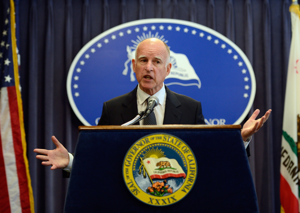 California Gov. Jerry Brown discusses pension reform during a news conference in Los Angeles. The governor just signed a bill that would create a retirement plan for millions of workers in the state who don't currently have access to one.