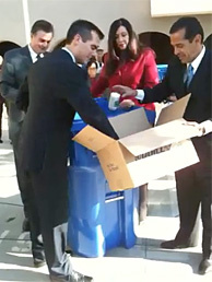 LA Mayor Antonio Villaraigosa and Council President Eric Garcetti demonstrate LA's wide-ranging capacity to recycle lots of different substances. The mayor says he wants a 70% recycling rate within 4 years.