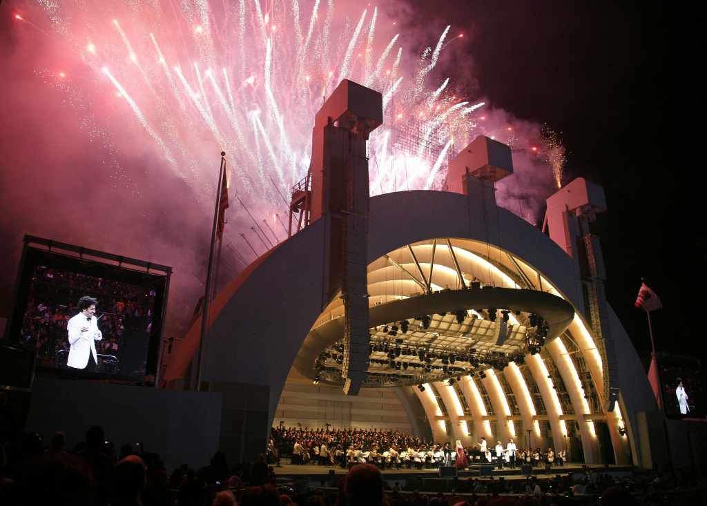 File photo: Fireworks erupt during the finale as Gustavo Dudamel makes his Hollywood Bowl debut as director of the Los Angeles Philharmonic in Los Angeles on Saturday, Oct. 3, 2009. The 28-year-old Venezuelan conductor was welcomed with a free community concert entitled