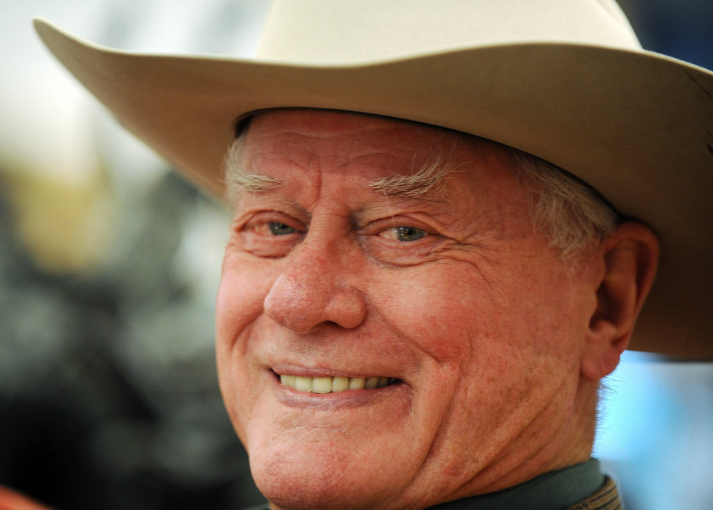 "In this file photo, actor Larry Hagman poses during a press preview of the auction of his personal antiques, fine and decorative art, furniture, and memorabilia from the classic 1980'??s primetime soap opera ""Dallas"" on May 24, 2011."