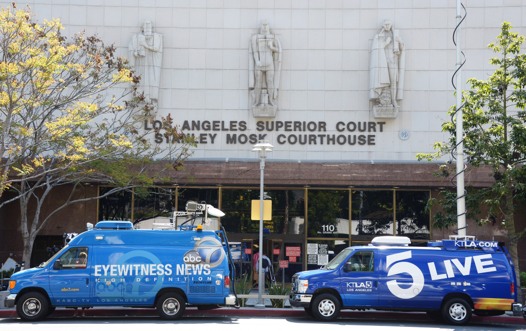 File: Television news broadcasting vans parked outside of Los Angeles Superior Court.