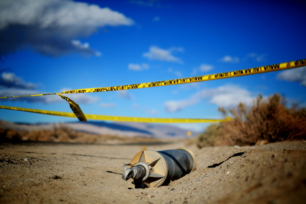 Debris from SpaceShipTwo lies in a desert field on November 1, 2014, in Mojave, California.  The Virgin Galactic SpaceShipTwo crashed on October 31, 2014 during a test flight, killing one pilot and seriously injuring another.