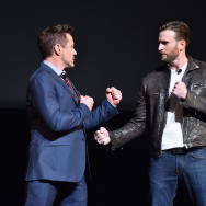 LOS ANGELES, CA - OCTOBER 28:  Actors Robert Downey Jr. (L) and Chris Evans onstage during Marvel Studios fan event at The El Capitan Theatre on October 28, 2014 in Los Angeles, California.  (Photo by Alberto E. Rodriguez/Getty Images  for Disney)