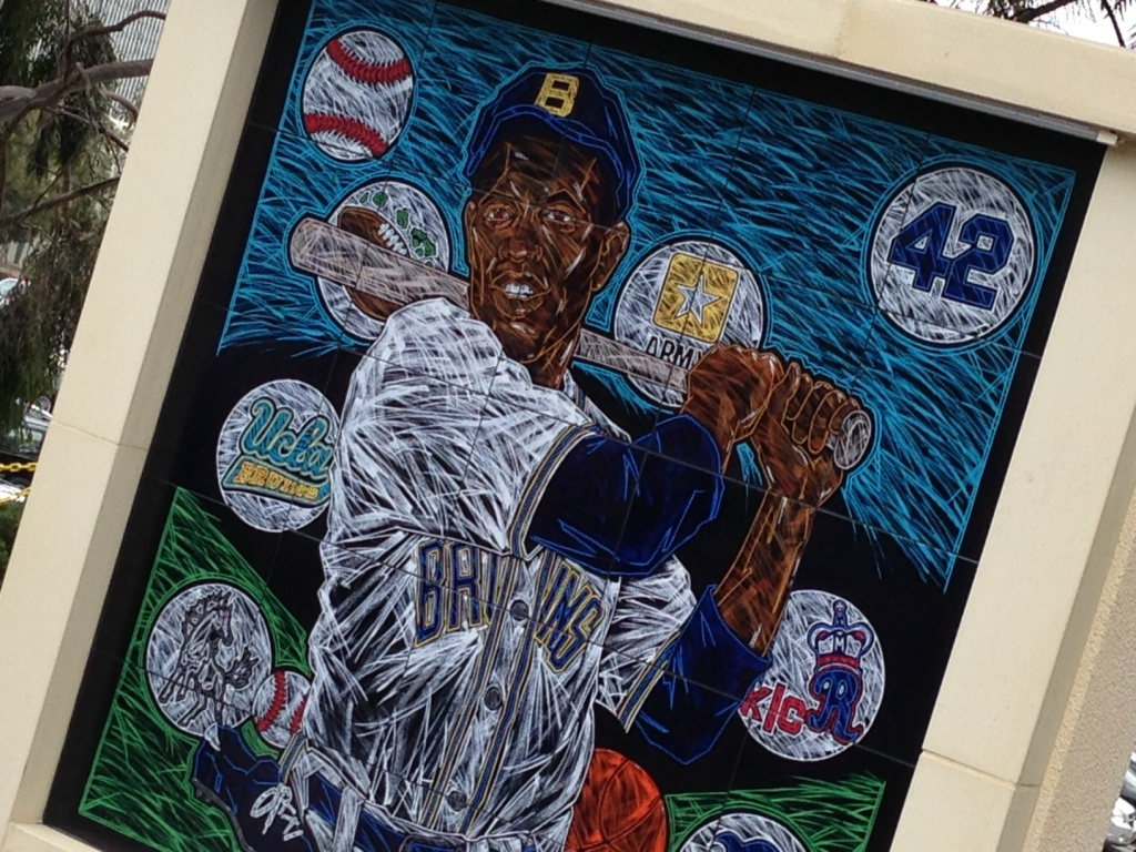 Artist Mike Sullivan's mural of Jackie Robinson is one of a series of 25 being donated to colleges around the country. It contains numerous references to the former Bruin's athletic legacy.