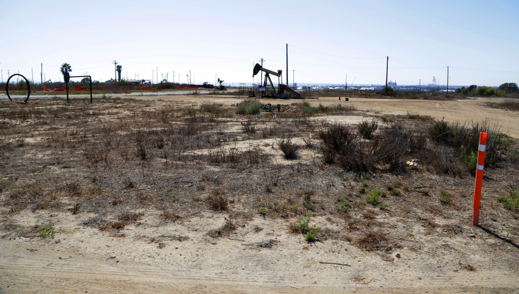 This Aug. 18, 2016 photo shows what remains of an oil-extraction operation in Banning Ranch, on what is believed to be the biggest piece of privately-owned vacant land on Southern California's coast in Newport Beach. Developers want to build 895 homes and a 75-room resort hotel on the 401-acre swath of land in upscale Newport Beach. Proponents say they would rehabilitate and preserve much of the scenic site, but opponents say the land should be left as open space. Native American groups have also begun to look into whether the site might be sacred ground.
