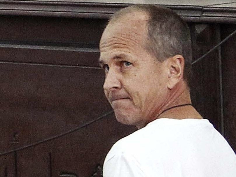 Al-Jazeera English correspondent Peter Greste, appears in court March 31, 2014, along with several other defendants during their trial on terrorism charges, in Cairo, Egypt. Greste, who was freed Sunday, is en route to Australia.