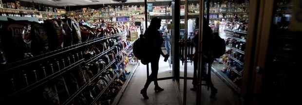 Deborah Springs shops in a convenience store for food items after a power outage Thursday, Sept. 8, 2011, in San Diego.
