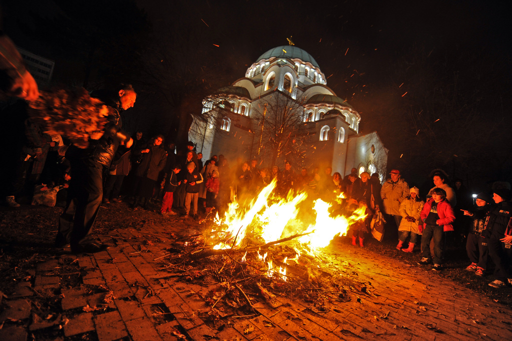 Serbs burn oak branches during Christmas Eve in front of the Saint Sava church in Belgrade, on January 6, 2012.