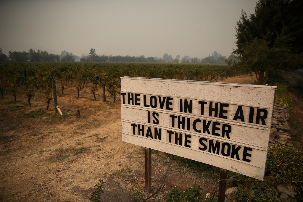 A sign posted outside Cline Cellars on October 13, 2017 in Sonoma, California after wildfires burned tens of thousands of acres and destroyed thousands of homes.