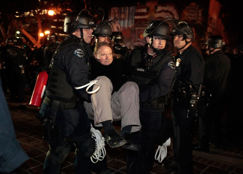 Los Angeles Police Department officers arrest a protester during the removal of the Occupy L.A. tent encampment outside City Hall in the early hours of November 30, 2011 in Los Angeles California.