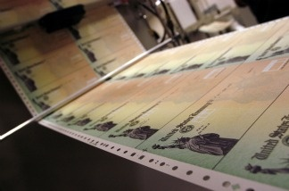 Blank Social Security checks are run through a printer at the U.S. Treasury in Philadelphia, Pennsylvania.