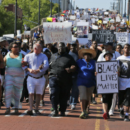 In this Sunday, July 10, 2016 file photo, people march in a Black Lives Matter rally in Oklahoma City. Black Lives Matter has quietly established a legal partnership with a California charity in a sign of the movement's growth and expanding ambition.
